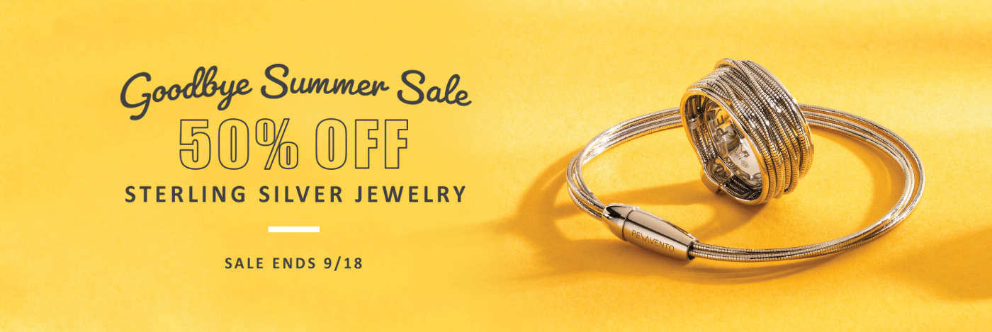Silver jewelry on yellow background